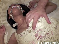 Check out this scene where the kinky Asian babe Azusa Watabe being masturbated as this guy shoves a dildo up her tight pussy while wearing a gag ball.