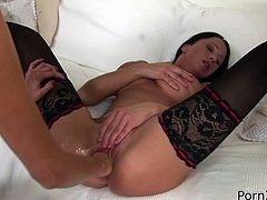 This brunette temptress in black stockings is so fucking horny that's unbelievable. In this hot sex video she gets her pussy fisted hard like never before.