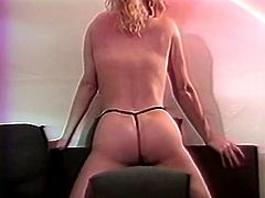Mind blowing light haired sexpot stares at the camera while stroking her natural C cups and her round jiggly butt in thongs. Babe puts on tight white pantyhose and rubs her crotch.