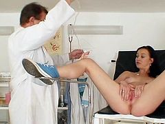 Lusty brunette spreads her legs and lets her doc to play down her juicy twat