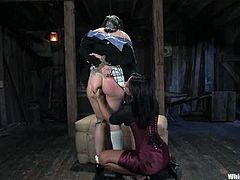 Alexa Von Tess and Sandra Romain are getting naughty in a basement. The dominatrix binds and suspends her slave and then destroys her coochie with a dildo.