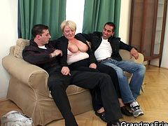 Me and my friend like older woman, like this slut right here, Ilona. She is a mature blond granny who loves young cock and gets pretty wild after a few drinks. As you can see, we enjoy playing with her huge boobs almost as much s she enjoys pulling out our dicks and giving us a couple of handjobs.