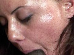 See a horny brunette and an alluring ebony bitch going lesbian while getting fucked by a hung black stud. The action here is non-stop! This ginger gets a hard cock doggy style!