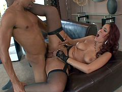 Pretty redhead sexy housemaid Isis Taylor with nice natural knockers in garter belt and stockings takes off uniform for Ethan Hunt and rides on his cock to loud orgasm.