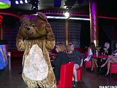 It's dancing bear time and these sluts are already drooling! The stripper comes in wearing her bear costume and entertains the whores until he strips and they open their mouths. First goes the blonde one that opens up her mouth and greets the guy with a mean suck. She loves having a hard cock between her lips!