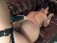 Olga Cabaeva and Penny Flame are playing dirty games indoors. The slave gets bound and pulled by the nipples and then gets her cunt fucked with a strapon and brutally fisted.