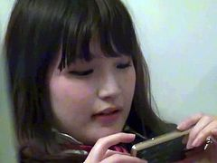 This sexy asian teenie is listening some music on her iPod and it makes her feel incredibly sexy. She spreads legs wide and uses her fingers to make herself cum.