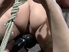 The extreme bondage that pushes Tiffany Tyler's flexibility to the limit is also going to leave her parts exposed for toying.