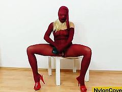 Barra Brass is a horny blonde slut with glasses and she wants to satisfy her nylon fetishes. Watch her spreading legs in red nylons and using her dildo to cum.