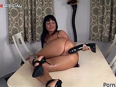 Make sure you have a look at this hot scene where the sexy brunette Angelica Heart shows off her big round tits before masturbating with a large dildo.