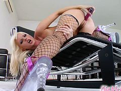 Make sure you see this! A gorgeous blonde, with a nice ass wearing a pink leather outfit with fishnet stockings, plays with a dildo and goes crazy!