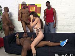 This sexy whore stupid enough to go with these black dude at their house. They start touching her and then gangbang that bitch with huge natural tits.