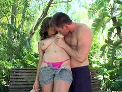 See the horny teen slut Chrissy Greene letting her man oil and play with her big round tits in the backyard.
