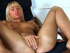 Insolent blonde likes to pose her shaved pussy while being well finger fucked