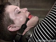 Infernal Restraints brings you a hell of a free porn video where you can see how a short-haired brunette gets tied up and abused by her master while assuming very hot poses.