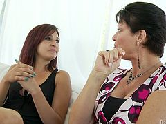 Vanessa Videl and Nikki Chase are playing with some dude's schlong indoors. The milf gives some blowjob tips to the girl and then they suck the boner and get cum in mouths.