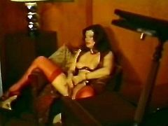 Busty dark haired whorish sex pot sits on chair and applies her dirty fingers to make her saggy hairy pussy feel good. Then her stud comes up to watch her pussy fingering... Take a look at this hungry bitch in The Classic Porn sex clip!