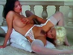 This Asian temptress with big tits looks very tempting in her sexy white stockings. She knows that she is driving her lesbian GF crazy. She spreads her sexy legs wide to let her GF get a taste of her delicious pussy.