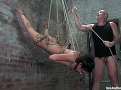 Sexy brunette Charley Chase is having fun with Mark Davis in a vault. Mark binds Charley, hangs her up and then pleases her with fingering and toying and fucks her sweet coochie from behind.