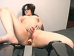 Naughty brunette girl takes her clothes and lies down on a special chair. She spreads her legs and gets her vagina drilled by the fucking machine.