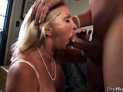Although she is a woman at certain age she knows how to please a man in bed. She sucks his shaft passionately to get it hard and ready. Then she rides him in cowgirl position. What a filthy whore!
