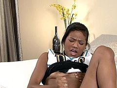 Talented ebony enjoys stroking her pussy with a big toy in rough solo action