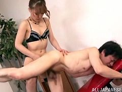 Get a load of this femdom scene where this sexy Asian babe dominates one of her coworkers in the office and ends up fucking him with a strapon.