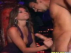 Sexy Victoria Lawson is having fun with some dude in a club. She kneels in front of the guy and strokes his prick before licking and sucking it hungrily.