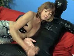 Club Tug brings you an amazing free porn video where you can see how the naughty brunette milf Dee Delmar gives great handjobs to a dude wearing a latex catsuit.
