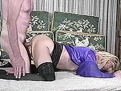 Sexy blonde girl gives a blowjob to old man. Then she lifts the dress up and gets hre vagina licked. After that she gets fucked doggystyle on a sofa.