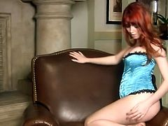 Check out sexy redheaded babe named Marie Mccray showing off her amazing body. First, she takes of her tiny panties and then her bra to show her big titties!
