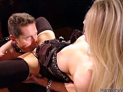 Take a look at this BDSM scene where the busty blonde Michelle Moist tortures her slave before taking a ride on his big fat cock.