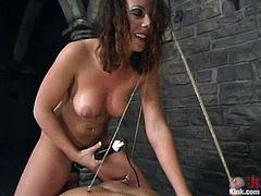 Danny Wylde is getting naughty with Penny Flame in a basement. He lets the hottie tie him up and then gets his dick pulled and his butt smashed with a strapon.