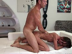 Dazzling brunette chick has wild anal sex with Rocco Siffredi. He bites his nipples and then gets her ass fingered. Later on she takes big cock in her ass.