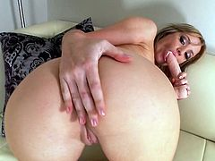 A fuckin' horny-ass slut sucks on a cock-shaped dildo and sticks it up her fuckin' gash in this arousing solo scene right here, check it out!