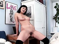 Vanessa Vaughn has fire in her eyes as she dildos her cunt
