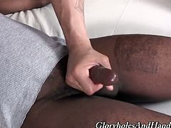 Handjob by gay is on the screen! Two homos get naked and start immersing in the gay passion. White one is wanking a huge black one!