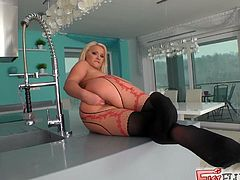 Sexy blonde bitch Lana wearing a pantyhose is having fun in the bathroom. She slams her shaved cunt with a big dildo and then pleases herself with fisting.