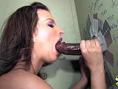 Sexy brown-haired milf Bailey Brooks sucks a BBC through a gloryhole. Then she gets her cunt pounded and feels glad to get her face splattered with jizz.