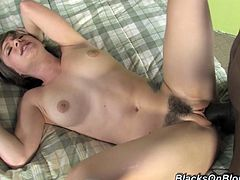A fuckin' slutty-ass chick sucks on a big black cock and then gets it shoved balls deep into her fuckin' pussy, check it out right here!