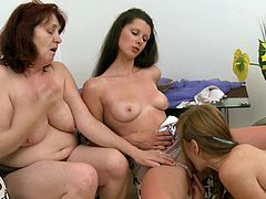 Hot mom along younger daughters are having fun masturbating in threesome together