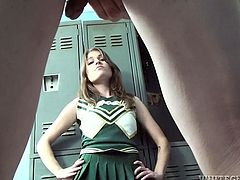 Beautiful brownie in cheerleader uniform drops to her knees and starts to suck a dick in a locker room. This babe also gets jizzed on her tits.
