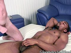 This horny white guy loves the black cock so much he can't keep his hands off it so he gives this ebony stud a wicked handjob.