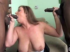 This white girl swallows one black cock down her throat while another hung, ebony stud pounds her pink pussy from behind.