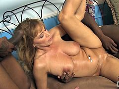 Wild cougar has passionate MMF sex. She sucks big black cock and gets her pussy drilled hard at the same time. In the end she gets her face cum covered massively.