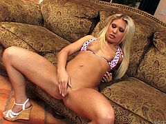 Sweet blonde girl in a bikini plays with her pussy lying on a sofa. Later on she gives a blowjob with pleasure and gets her shaved pussy fucked deep.