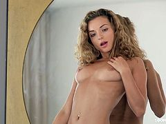 This is a hot solo scene with a sizzling blond honey Alyssa A! She is a divine curly haired honey that loves it in sensual way!