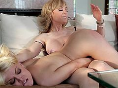 Ash Hollywood and Nina Hartley are undressing