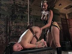 Delilah Strong and Sindee Jennings are having some fun in a basement. The blonde ties the brunette up and pours hot wax on her ass and then slams her cooch with a dildo and fists it hard afterwards.