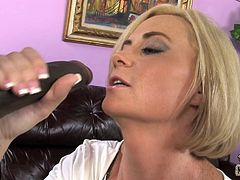 Cougar is getting facialized by a huge black cock